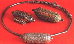 silver chains and charm containers