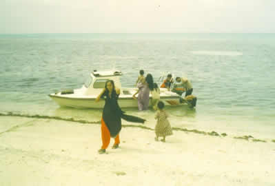 Disembarking for picnic at Viringili island off Minicoy. May 2004